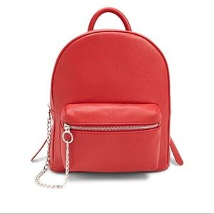 Red faux leather mini backpack with chain